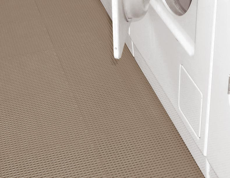 Laundry room flooring with a washer and dryer